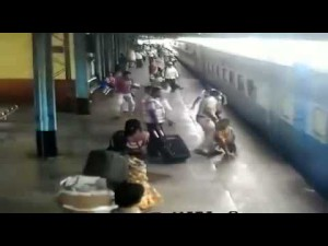 Watch Policeman saves woman who Fell Off Train at Railway station